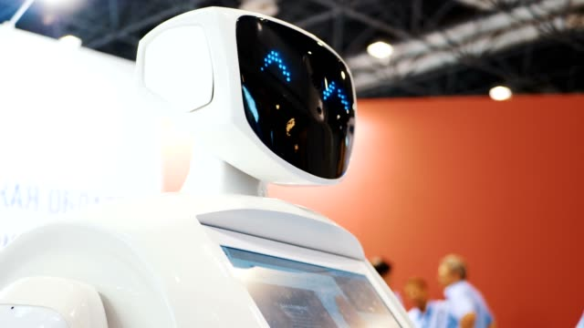 A robot to communicate with people. Artificial Intelligence. The robot turns its head and talks. Modern Robotic Technologies. The robot looks at the camera at the person. The robot shows emotions. video