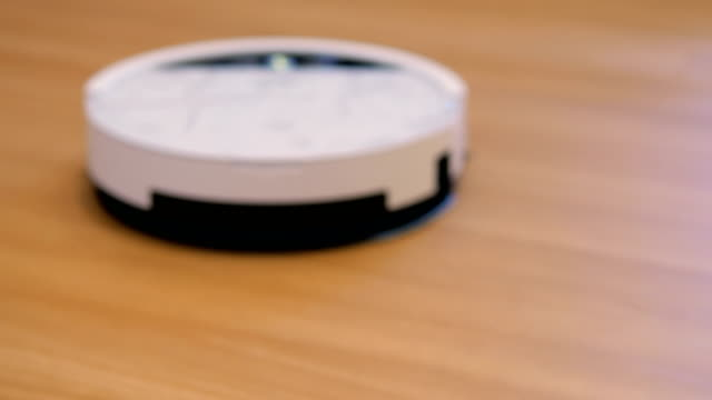 Robot vacuum cleaner  : Wood Laminate Flooring Modern Life appliance stock videos & royalty-free footage