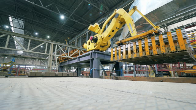 Robotic Arm production line. Robot is transporting bricks in batches Loading vehicle is transporting bricks in batches. 4K robot arm stock videos & royalty-free footage