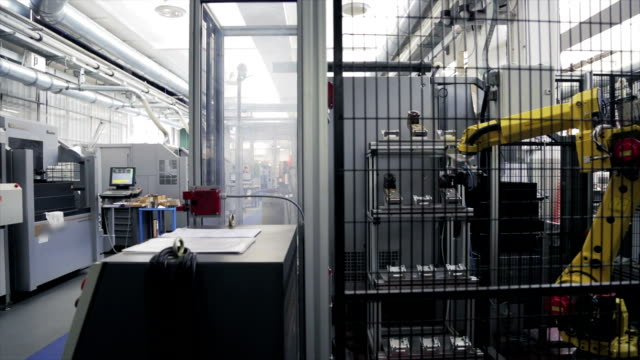 Robotic arms in a car factory video