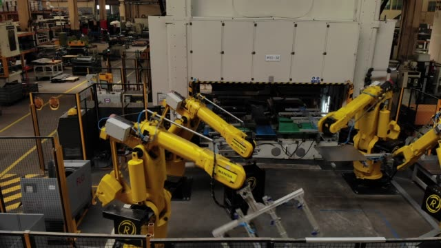 Robotic Arms in a Factory Robotic Arms in a Factory computer aided manufacturing stock videos & royalty-free footage