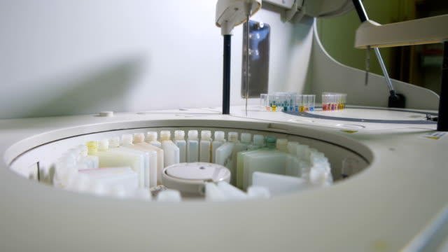 Robotic equipment puts Medical Samples on the Conveyor Line. Chemistry, pharmaceutical, medical equipment. Close up. video