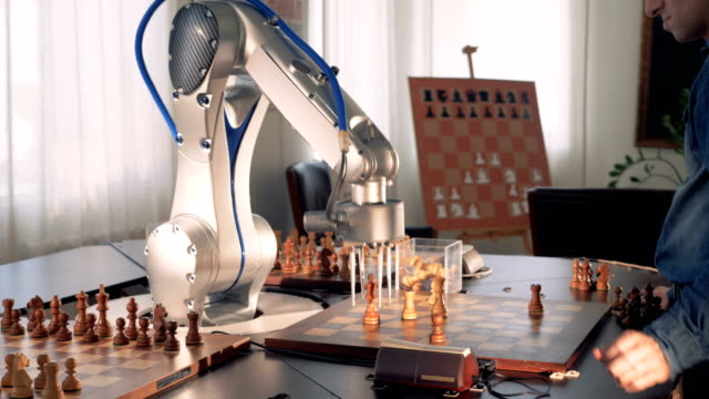 Robotic hand playing chess. Artificial intelligence concept. 4K. video