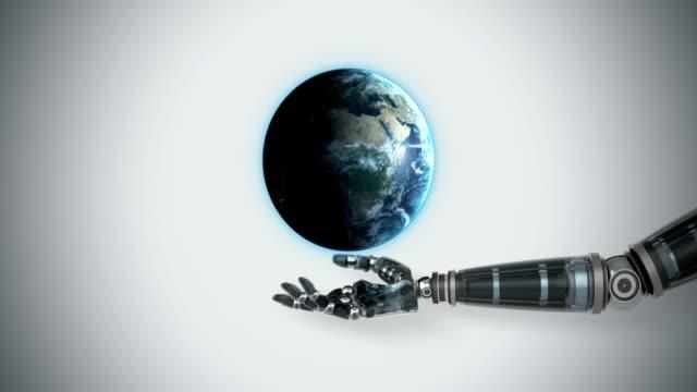 robotic hand presenting digital globe - 20 29 lat filmów i materiałów b-roll