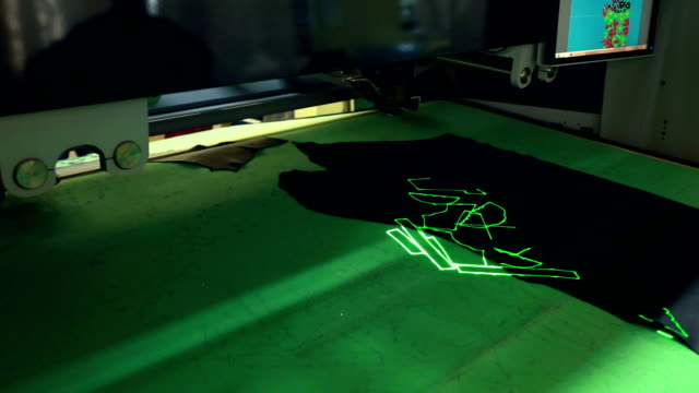 Robotic machine cuts leather with laser marking video