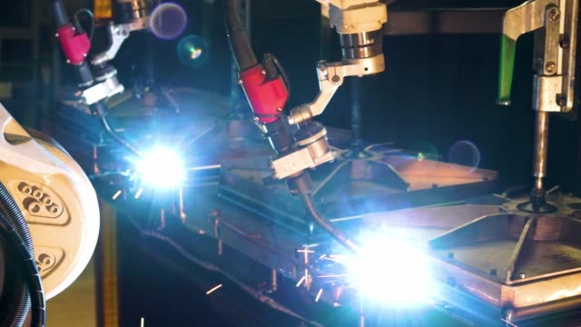 A robotic welder in operation in a manufacturing plant A robotic welder in operation in a manufacturing plant computer aided manufacturing stock videos & royalty-free footage