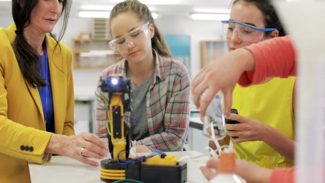Robotics Lesson Teenagers getting a lesson in robotics in high school. elementary age stock videos & royalty-free footage
