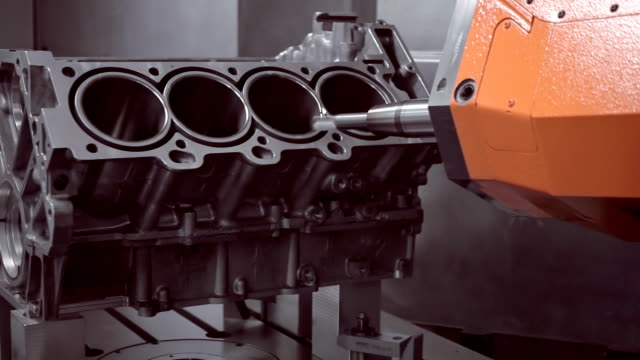 Robot's arm on the program performs the milling of the cylinder of the engine The robot's arm on the program performs the milling of the cylinder block of the internal combustion engine vehicle part stock videos & royalty-free footage