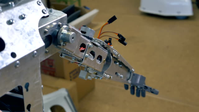 A robots arm with sticking out cables. video