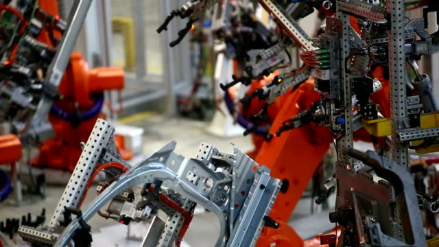 Robots Assembling Car Body Real time shot made with LEICA Apo-Summicron-R 180mm f/2 lens. robot arm stock videos & royalty-free footage