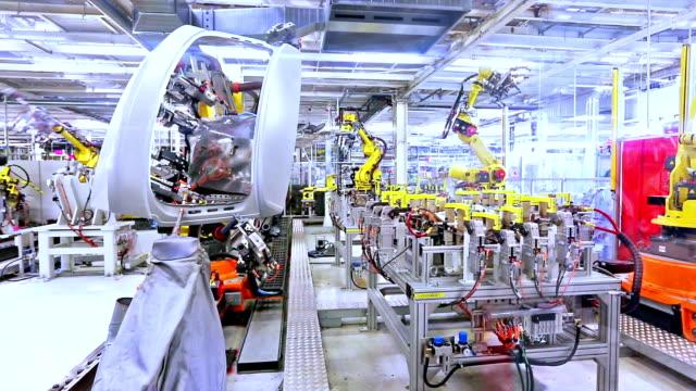 自動車工場のロボット - 重い点の映像素材/bロール