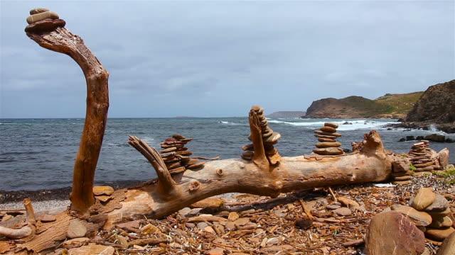 Rock balancing at the beach video