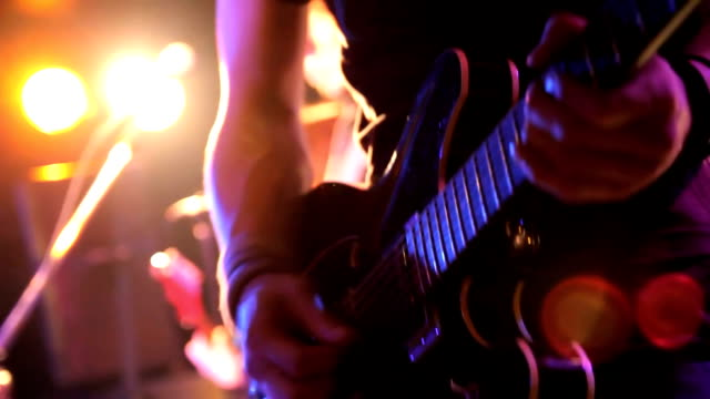 Rock band performing on stage. Tokyo, Japan Selective Focus. guitar stock videos & royalty-free footage