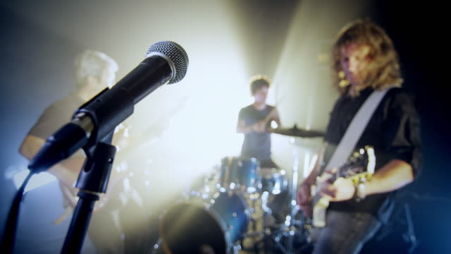 rock band eseguire sul palco - musicians singers during lockdown video stock e b–roll