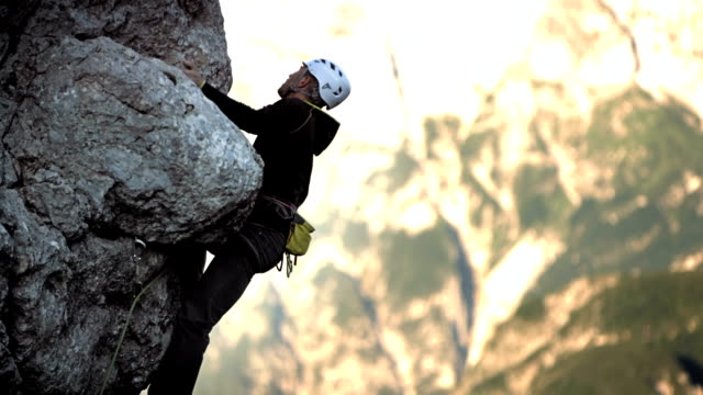 hd: rock climber climbing the cliff - body conscious stock videos & royalty-free footage