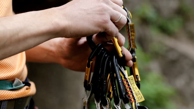Rock climber clings carbines