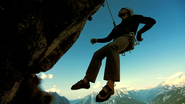 HD: Rock Climber Hanging On A Rope