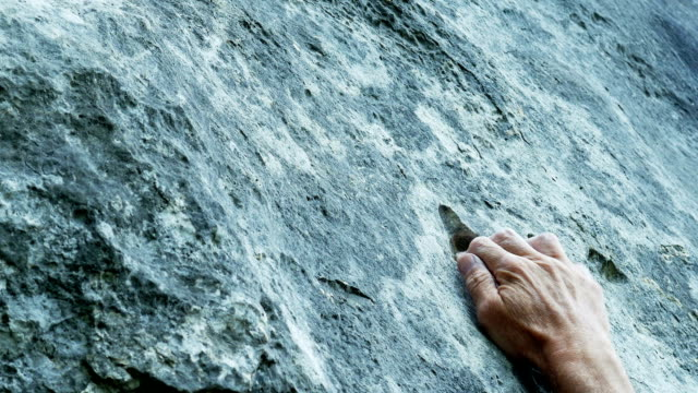 Rock Climber Searching For Hold Close-up (4K/UHD to HD) video