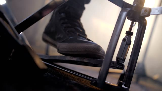 Rock drummer beating rhythm with foot on drum kit Close-up of musician's leg pressing foot pedal on drum set during recording rock music in smoky studio. Musician in black sneakers beating rhythm with foot to sound hi-hat cymbal while playing drums rock music stock videos & royalty-free footage