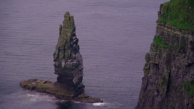 A rock formation in the sea in Cliffs of Moher in Ireland video