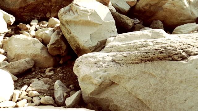 Rock Sliding HD1080p : Rock Sliding In Mountains. boulder rock stock videos & royalty-free footage