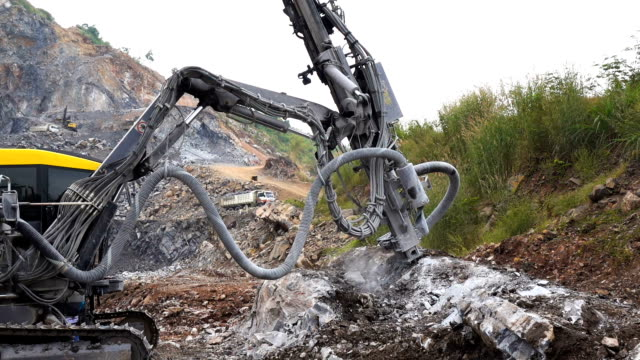 Rock surface drilling machine used to drill blast holes at quarry site video