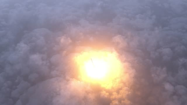 Rocket flies through the clouds Rocket flies through the clouds to space nuclear missile stock videos & royalty-free footage