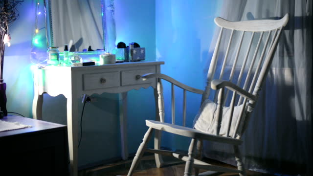 Rocking chair Empty, white rocking chair rocks on wood floor. rocking chair stock videos & royalty-free footage