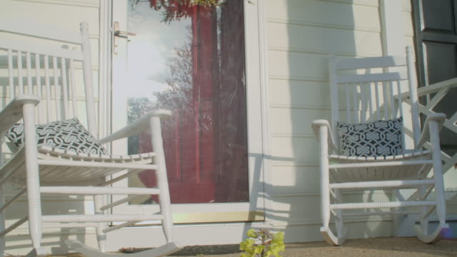 Rocking chairs on a front porch Rocking chairs on a front porch rocking chair stock videos & royalty-free footage