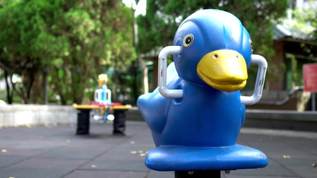 rocking duck with seesaw in the park. - summer background стоковые видео и кадры b-roll