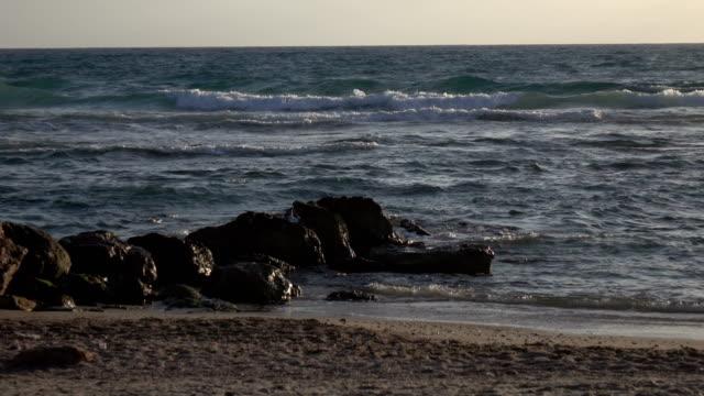 Rocks in Water on Beach on Mediterranean video