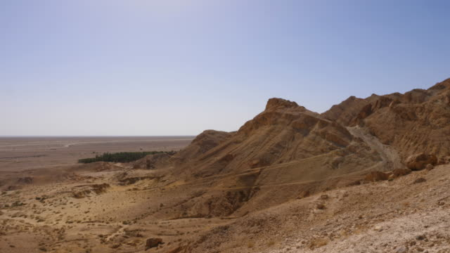 Rocky mountains in Sahara desert on sunny day, panoramic view Rocky mountains in Sahara desert on sunny day, panoramic view. Chebika canyon in summer, Tunisia, North Africa canyon stock videos & royalty-free footage