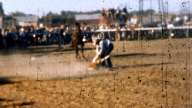 rodeo cowboy calf roping (archival 1950s) - rodeo stock videos and b-roll footage