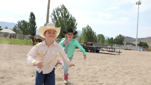 Rodeo Kids Running in Arena
