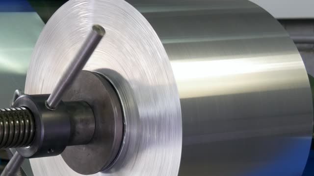 roll of metal sheets on industrial cnc machine. - acciaio video stock e b–roll