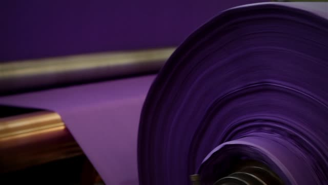 roll of purple fabric, fabric industry. - barile video stock e b–roll