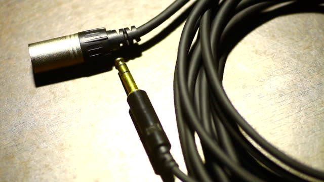 Rolled up cables with jacks video