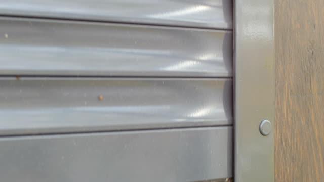 roller shutter closed - store filmów i materiałów b-roll