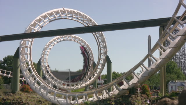 rollercoaster corkscrew hd - roller coaster stock videos & royalty-free footage
