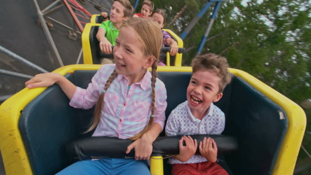 Roller-Coaster Ride Group of kids shouting while riding a roller coaster carnival celebration event stock videos & royalty-free footage