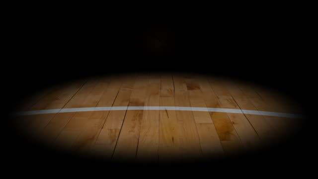 stockvideo's en b-roll-footage met rolling basketball into the light - basketbal teamsport