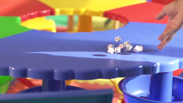 rolling dice on table video