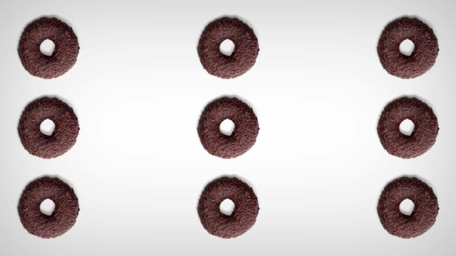 rolling donuts isolated on white background. top view - top filmów i materiałów b-roll