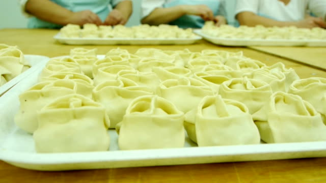 rolling dough and making dumplings rolling dough and making dumplings. cookie cutter stock videos & royalty-free footage