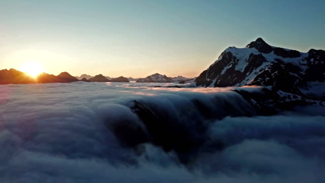Rolling fog and sunrise at Mt Shuksan - 4k aerial time lapse video