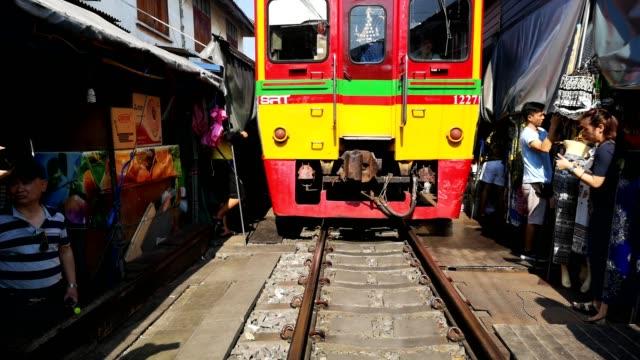 Rom Hup Maeklong railroad tracks market (Train Market), Samut Songkham, Thailand.
