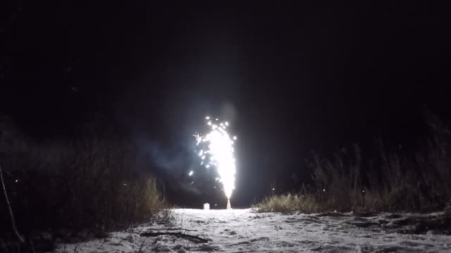 Roman candle fireworks View of fireworks of working Roman candle in the night. Roman candle stands on the snow. New Year's Eve. Theme of celebrating holidays at home. fireworks videos stock videos & royalty-free footage