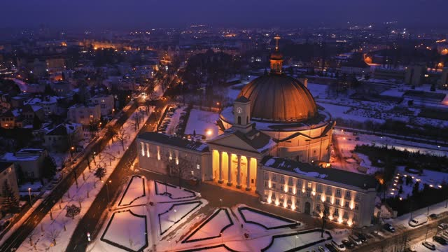 Roman Catholic Basilica of st. Vincent de Paul, Bydgoszcz Aerial view of Roman Catholic Basilica of st. Vincent de Paul in Bydgoszcz, winter at night neoclassical architecture stock videos & royalty-free footage