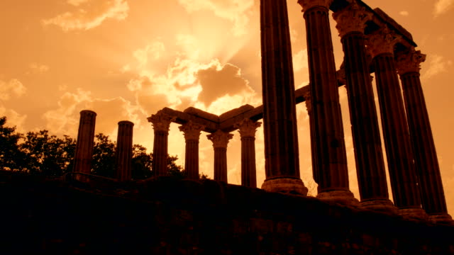Roman Temple of Evora - Temple of Diana - Evora, Portugal Cinematic sunset shot of the beautiful Roman Temple of Evora, or Temple of Diana, a significant landmark dating to 1st century AD archaeology stock videos & royalty-free footage