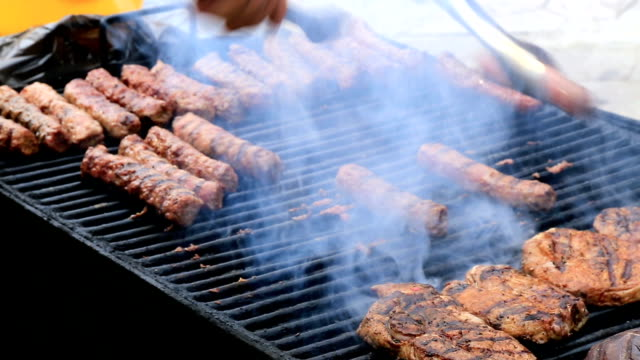 Romanian sausages (mici) cooked grill video
